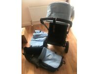 Bugaboo baby blue pram including rain cover, foot muff and parasol.