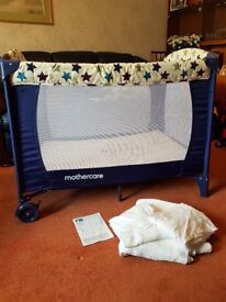 Travel cot with accessories
