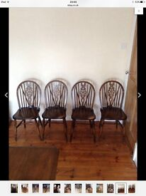 Table and six wheel back chairs