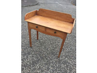 Pine ledgeback writing table /desk with 2 drawers . In good condition . Free Local Delivery.