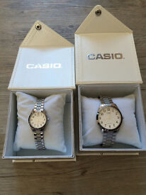 His and her matching Casio Quartz silver colored watches