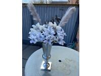 Artificial flowers complete in a vase