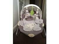 Baby's R us bouncer/motion chair, excellent cond, plays music &sounds, vibrates, plus textures