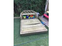 Plum sandpit with bench