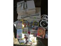Nintendo Wii with Fit Plus board, steering wheel and games