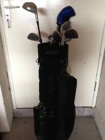 3 sets of golf clubs and trolley
