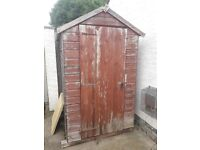 wooden shed with a new roll of roofing and plastic windows 6 by 4ft