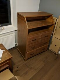 Chest of drawers with fold out top