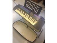 Yamaha PSR 77 keyboard with stand, mains adapter and lambs wool case