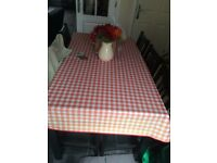 Black Dining Table and Six Chairs not with cushions as they were bought separately at £5.00 each