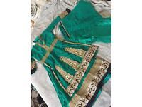 Asian clothes. Green shalwar suit