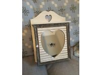Beautiful bathroom/bedroom cabinet with heart detail in pristine condition.