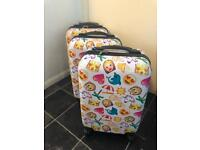 New without tags Small / medium sized Emoji suitcases x3