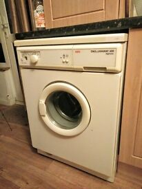 Washing machine, bit old school, in working order