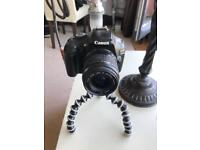 Eos 1100 d with lens charger and sd