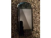 PSP incl protective sleeve one game and charger