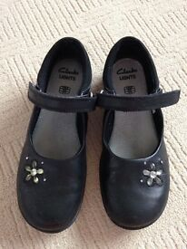 Girls Clarks lights black school shoes size 12 and a half E.