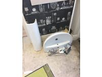 Bathroom sink / basin and tap.