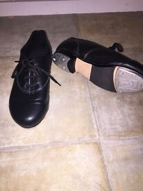 Revolution childrens black tap shoes. Size 13. Has toe and heel taps and very good condition .