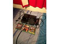 Xbox One with 2 Controllers and Battlefield Hardline, GTA V and Minecraft.