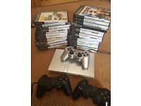 PlayStation 2 and 26 games and 3 controllers