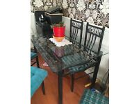 Glass top black metal dining table and 6 chairs