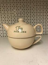 Tea pot with cup.