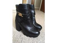 Black heeled boots size 5 with gold buckle