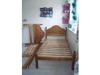 Pair of matching solid wood single bed frames.