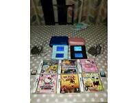 2x Nintendo DS Consoles plus 8 Games