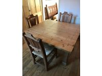 Hand made bespoke 4 seater pine table with 4 chairs and drop leaf top.