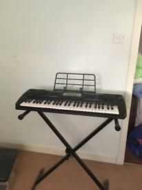 Keyboard with stand and mains adapter