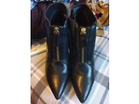 Brand new heeled boots size 6