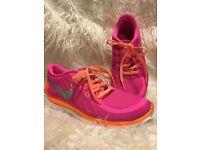Pink and orange Nike Free 5.0