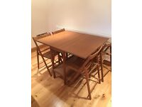 Wooden Dining Table and Four Chairs, conveniently folds away to save space!