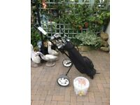 Set of 21 golf clubs with trolley