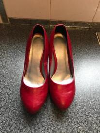 Rose high heels shoes in red colour