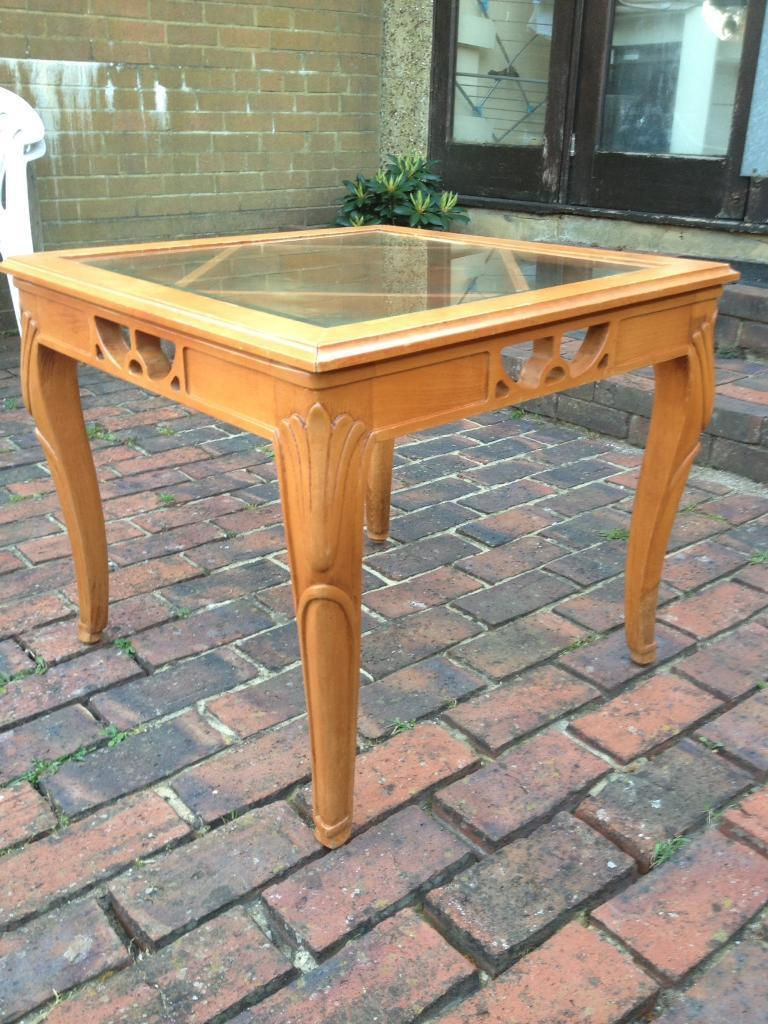 BEVELLED GLASS TABLE WITH DECORATIVE WOODEN FRAMEin Hove, East SussexGumtree - Lovely square bevelled glass table with carved decorative wooden frame. In good condition as well looked after. Measurements Width 65.5cmHeight 56cm£35 ONO )Any questions please ask
