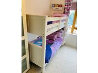 Bunk bed with mattress and beddings.