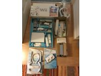 Nintendo Wii complete box set including tennis and golf. Recently opened but never used!
