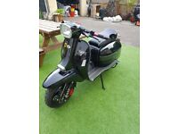 Scomadi TL50 in Onyx Black with PM Tuning Exhaust and Extras
