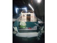 18ft cabin cruiser complete whith trailer radio flares life jackets etc
