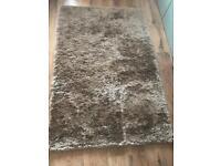 Next, natural coloured shimmer rug