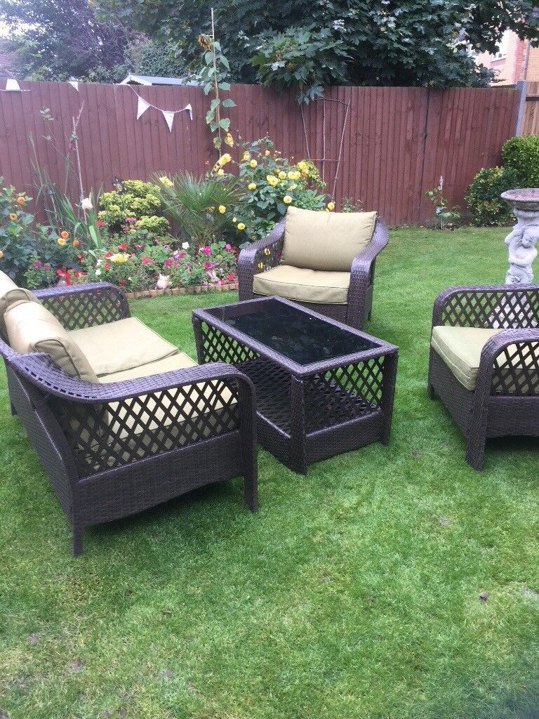 Garden furniture settee plus two chairs   cushions   glass top table. Garden furniture settee plus two chairs   cushions   glass top