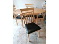 Extendable dining table & 4 padded leather chairs