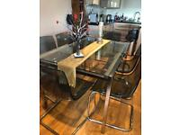 Glass extendable dining table and 6 chairs