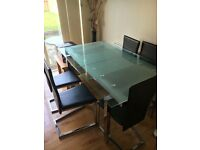 BEAUTIFUL EXTENDING SIX SEATER GLASS TABLE AND CHAI