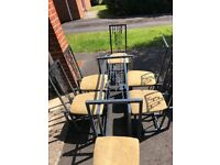Heavy solid metal and glass dining table and 6 chairs
