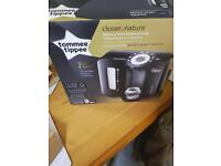 Tommee Tippee black perfect prep machine with new filter and new bottles.