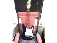JAY TURNER BLUE STRAT STYLE ELECTRIC GUITAR WITH PICK HOLDER AT SIDE OF JACK SOCKET